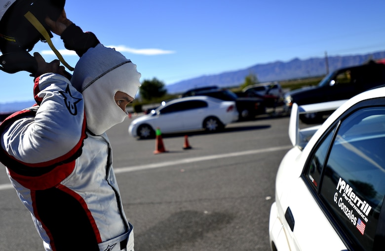 Tech. Sgt. Gabriel, a 432nd Wing/432nd Air Expeditionary Wing MQ-9 Reaper sensor operator, takes his helmet off after racing at the Spring Mountain Raceway Nov. 1, 2015, in Pahrump, Nevada. Gabriel participated in the race as part of the Redline Time Attack series which puts races in different class against the clock to see who can get the fastest time. Gabriel placed second in second highest class. (U.S. Air Force photo/Airman 1st Class Christian Clausen)