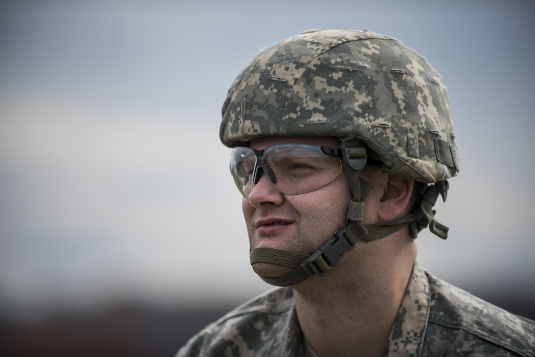 Spc. Josh Delles, a U.S. Army Reserve Soldier with the 354th Military Police Company, of St. Louis, looks on during an M2 Browning .50-caliber machine gun familiarization range at Camp Atterbury, Ind., Nov. 5. The 384th Military Police Battalion, headquartered at Fort Wayne, Ind., organized a three-day range and field training exercise involving more than 550 U.S. Army Reserve Soldiers and incorporated eight different weapons systems, plus combat patrolling and a rifle marksmanship competition at Camp Atterbury, Ind., Nov. 5-7. (U.S. Army photo by Master Sgt. Michel Sauret)