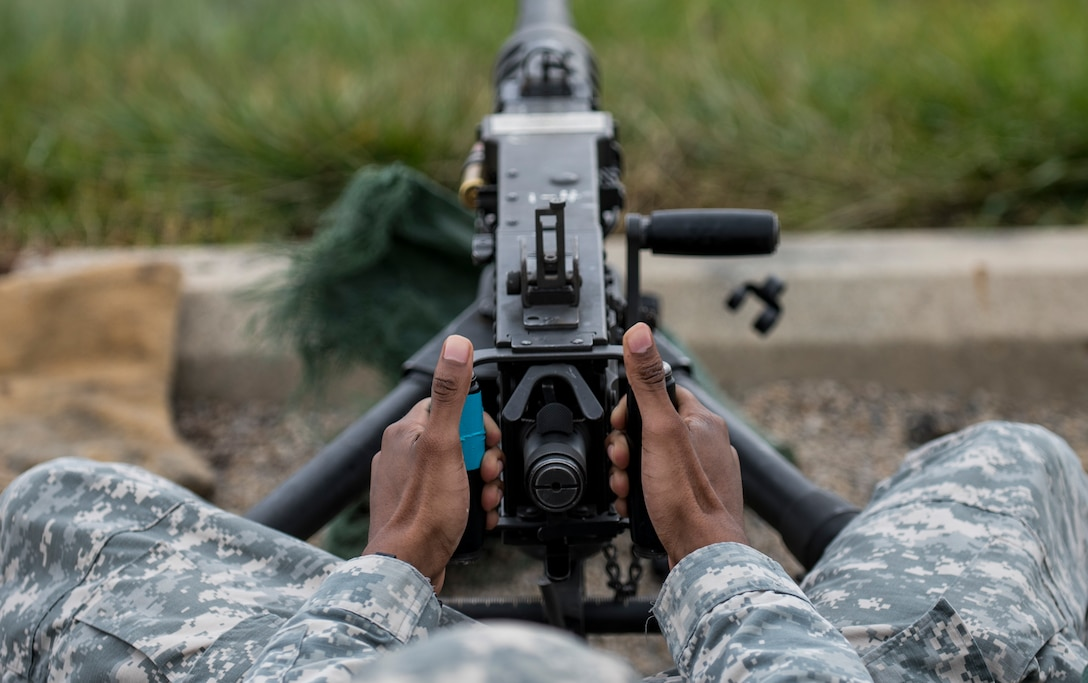 A U.S. Army Reserve Soldier from the 354th Military Police Company, of St. Louis, releases the trigger of an M2 Browning .50-caliber machine gun during a familiarization range at Camp Atterbury, Ind., Nov. 5. The 384th Military Police Battalion, headquartered at Fort Wayne, Ind., organized a three-day range and field training exercise involving more than 550 U.S. Army Reserve Soldiers and incorporated eight different weapons systems, plus combat patrolling and a rifle marksmanship competition at Camp Atterbury, Ind., Nov. 5-7. (U.S. Army photo by Master Sgt. Michel Sauret)