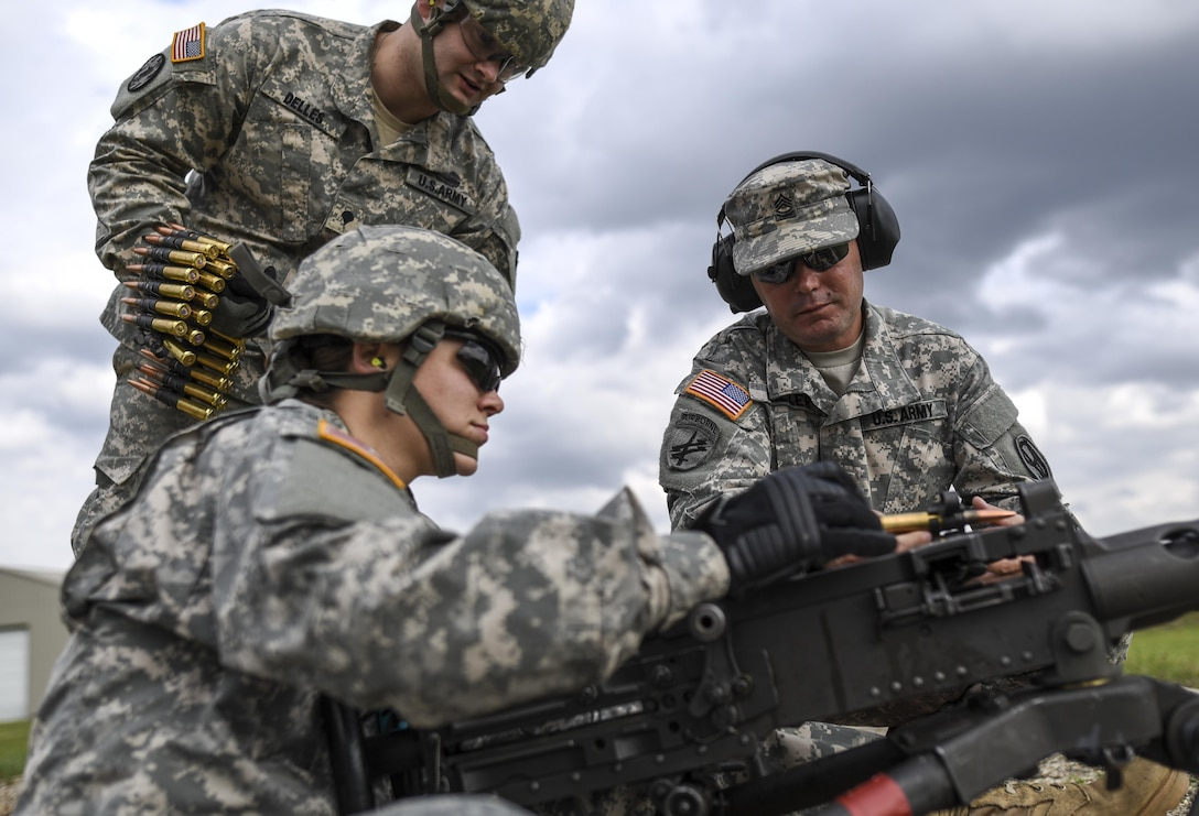 Cpl. Brittany Montana, a U.S. Army Reserve Soldier with the 354th Military Police Company, of St. Louis, loads a new clip of rounds into an M2 Browning .50-caliber machine gun during a familiarization range at Camp Atterbury, Ind., Nov. 5. The 384th Military Police Battalion, headquartered at Fort Wayne, Ind., organized a three-day range and field training exercise involving more than 550 U.S. Army Reserve Soldiers and incorporated eight different weapons systems, plus combat patrolling and a rifle marksmanship competition at Camp Atterbury, Ind., Nov. 5-7. (U.S. Army photo by Master Sgt. Michel Sauret)