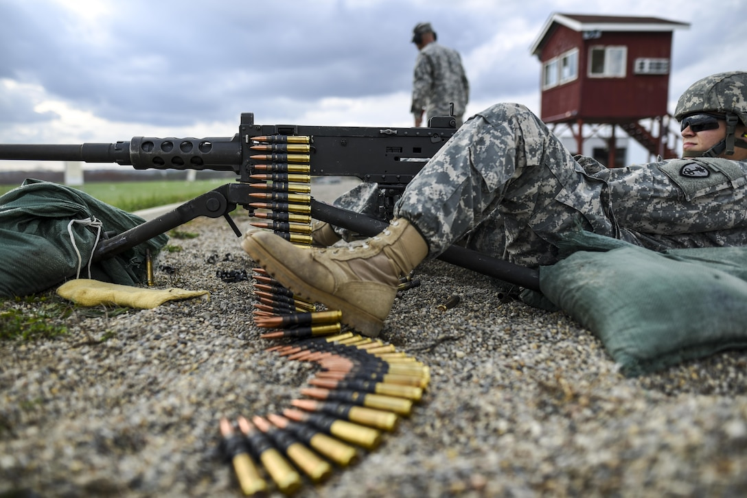 Cpl. Brittany Montana, a U.S. Army Reserve Soldier with the 354th Military Police Company, of St. Louis, fires an M2 Browning .50-caliber machine gun during a familiarization range at Camp Atterbury, Ind., Nov. 5. The 384th Military Police Battalion, headquartered at Fort Wayne, Ind., organized a three-day range and field training exercise involving more than 550 U.S. Army Reserve Soldiers and incorporated eight different weapons systems, plus combat patrolling and a rifle marksmanship competition at Camp Atterbury, Ind., Nov. 5-7. (U.S. Army photo by Master Sgt. Michel Sauret)