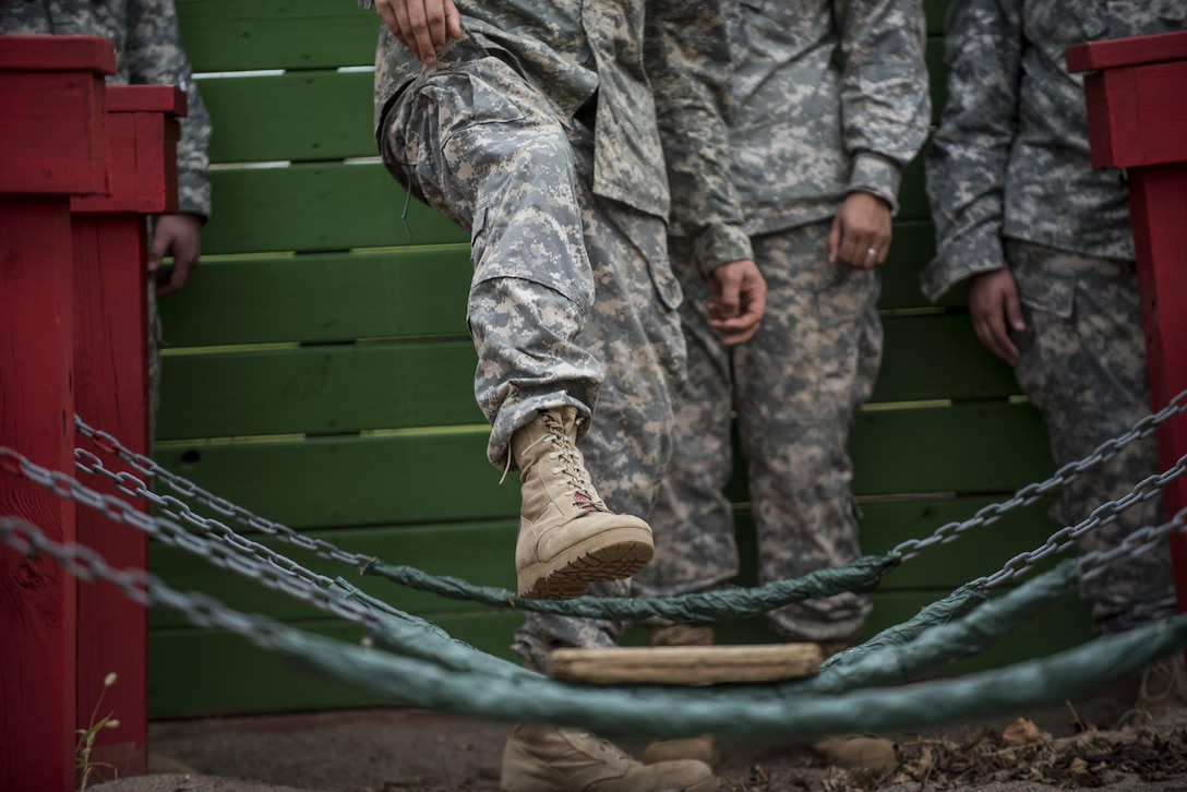 U.S. Army Reserve military police Soldiers navigate through a Leadership Reaction Course as part of a team-building exercise at Camp Atterbury, Ind., Nov. 5, during a three-day range training event hosted and organized by the 384th Military Police Battalion, headquartered at Fort Wayne, Ind. The field training involving more than 550 U.S. Army Reserve Soldiers and included ranges using eight different weapons systems, plus combat patrolling and a rifle marskmanship competition. (U.S. Army photo by Master Sgt. Michel Sauret)