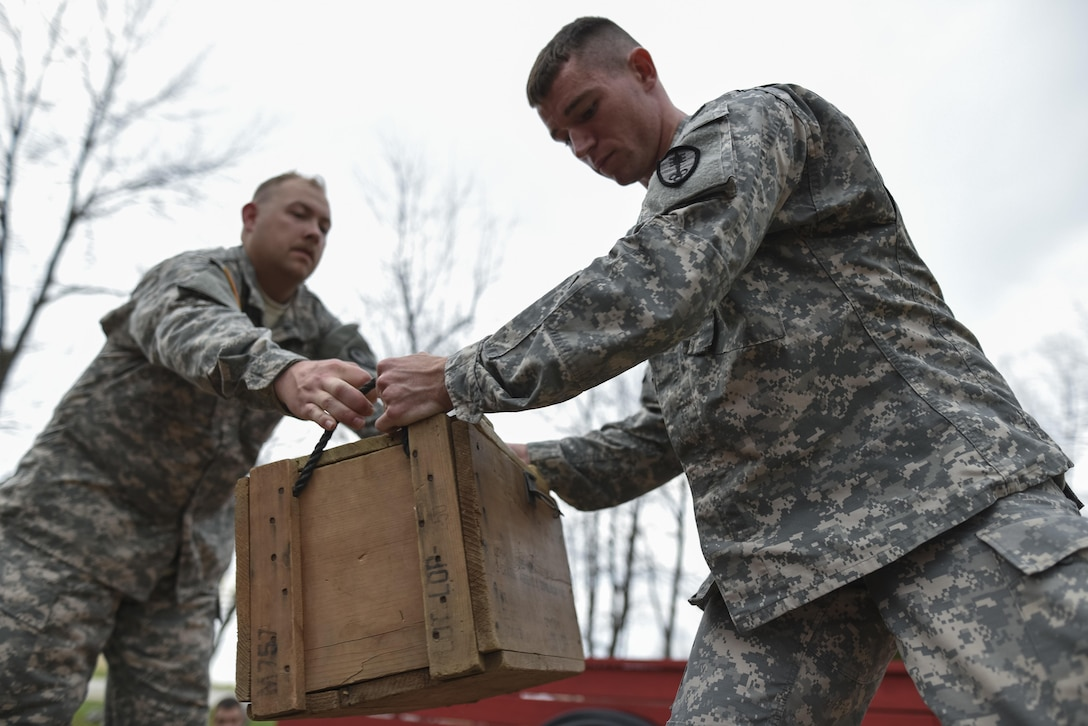 U.S. Army Reserve military police Soldiers pass along a box as they navigate through a Leadership Reaction Course as part of a team-building exercise at Camp Atterbury, Ind., Nov. 5, during a three-day range training event hosted and organized by the 384th Military Police Battalion, headquartered at Fort Wayne, Ind. The field training involving more than 550 U.S. Army Reserve Soldiers and included ranges using eight different weapons systems, plus combat patrolling and a rifle marskmanship competition. (U.S. Army photo by Master Sgt. Michel Sauret)