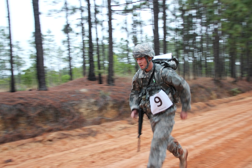 Staff Sgt. Andrew Paulsen, 350th Civil Affairs Command, runs to the finish line of his 10 kilometer ruck march, May 1. Paulsen finished second, just mere seconds behind the first man to cross. U.S. Army Civil Affairs & Psychological Operations Command (Airborne) competitors came from around the country to compete in this year's Best Warrior Competition held at Fort Bragg, N.C., April 29 through May 3, to earn the honor of representing the command at the U.S. Army Reserve Command's competition in June. (U.S. Army photo by Staff Sgt. Sharilyn Wells/USACAPOC(A))