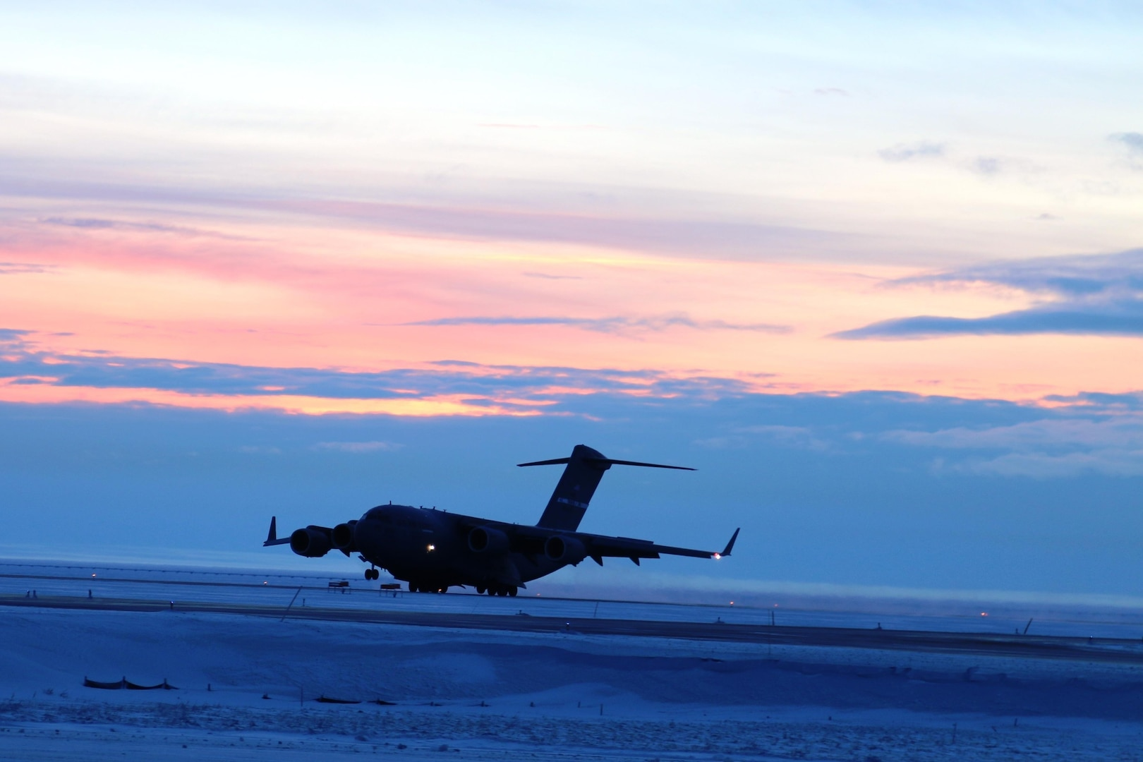 A U.S. Air Force C-17 Globemaster landing on the icy tarmac at Deadhorse, Alaska, after successfully deploying part of a Stryker platoon assigned to U.S. Army Alaska's Bravo Company, 3-21 Infantry Regiment, 1st Stryker Brigade Combat Team, Nov. 3, 2015. Operation Arctic Pegasus is U.S. Army Alaska's annual joint exercise designed to test rapid-deployment and readiness in the Arctic. The exercise marks the first time Strykers have deployed above the Arctic Circle. The 1st Stryker Brigade Combat Team is the Army's northernmost unit and has the unique capability to deploy and operate in extreme cold regions. (Photo by Capt. Richard Packer, U.S. Army Alaska Public Affairs)