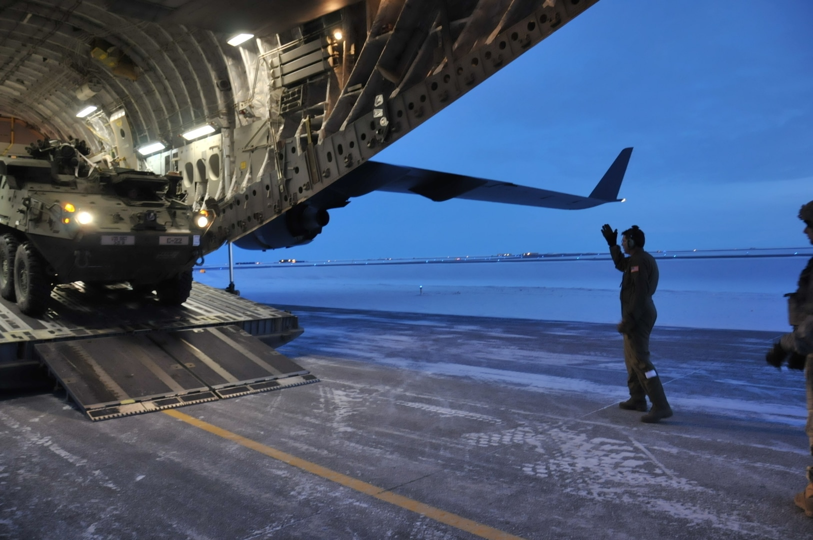 U.S. Army Alaska Strykers, assigned to Bravo Company, 3-21 Infantry Regiment, 1st Stryker Brigade Combat Team, offloads from an Air Force C-17 Globemaster above the Arctic Circle as part of Operation Arctic Pegasus at Deadhorse, Alaska, Nov. 3, 2015.  Arctic Pegasus is U.S. Army Alaska's annual joint exercise designed to test rapid-deployment and readiness in the Arctic. The exercise marks the first time Strykers have deployed above the Arctic Circle. The 1st Stryker Brigade Combat Team is the Army's northernmost unit and has the unique capability to deploy and operate in extreme cold regions. (Photo by Sgt. 1st Class Joel Gibson, U.S. Army Alaska Public Affairs)