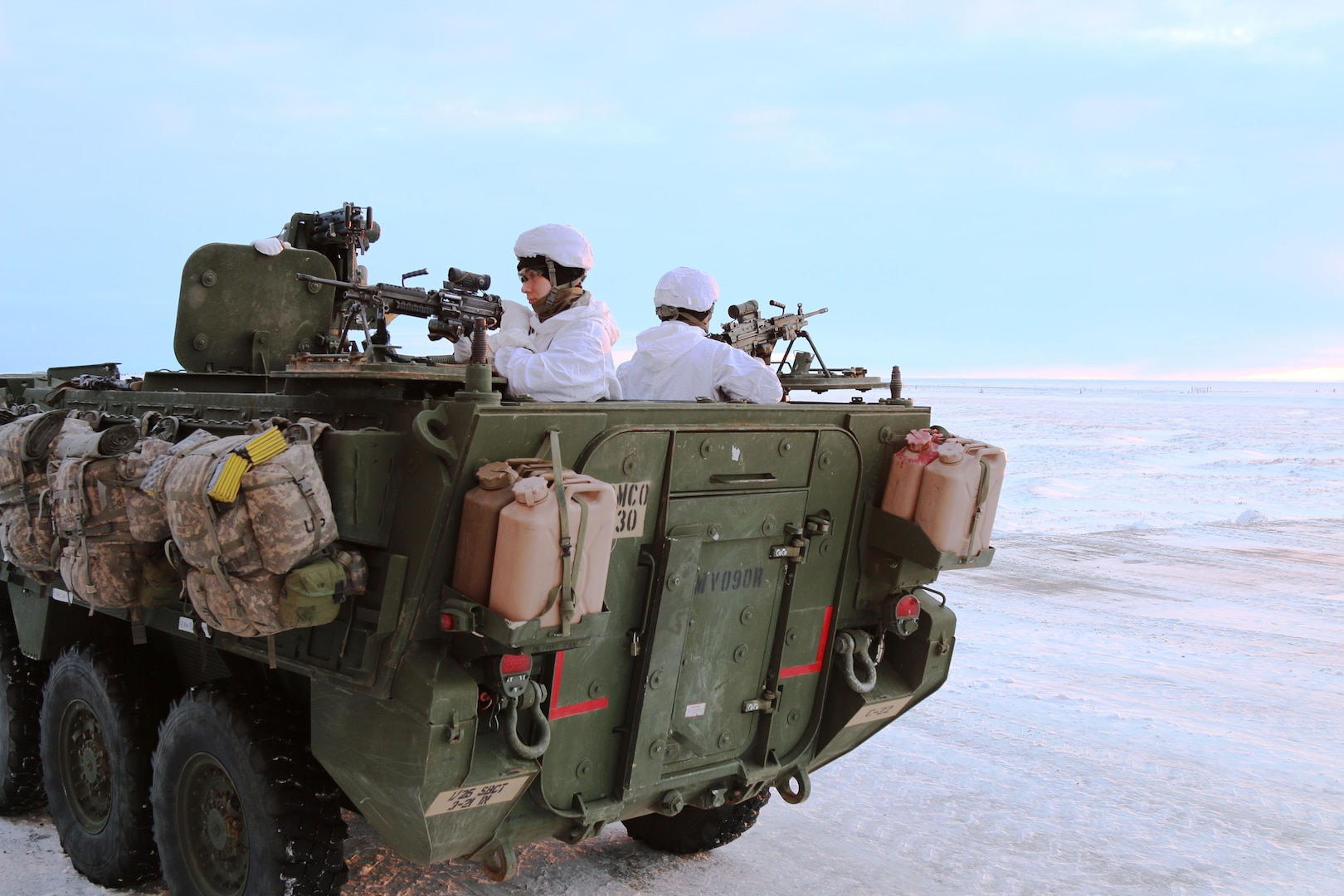 U.S. Army Alaska Soldiers from Bravo Company, 3-21 Infantry Regiment, 1st Stryker Brigade scanning the Arctic tundra outside Deadhorse, Alaska, during Operation Arctic Pegasus, Nov. 4, 2015. Arctic Pegasus is U.S. Army Alaska's annual joint exercise designed to test rapid-deployment and readiness in the Arctic. The exercise marks the first time Strykers have deployed above the Arctic Circle. 1st Stryker Brigade Combat Team is the Army's northernmost unit and has the unique capability to deploy and operate in extreme cold regions. (Photo by Capt. Richard Packer, U.S. Army Alaska Public Affairs)