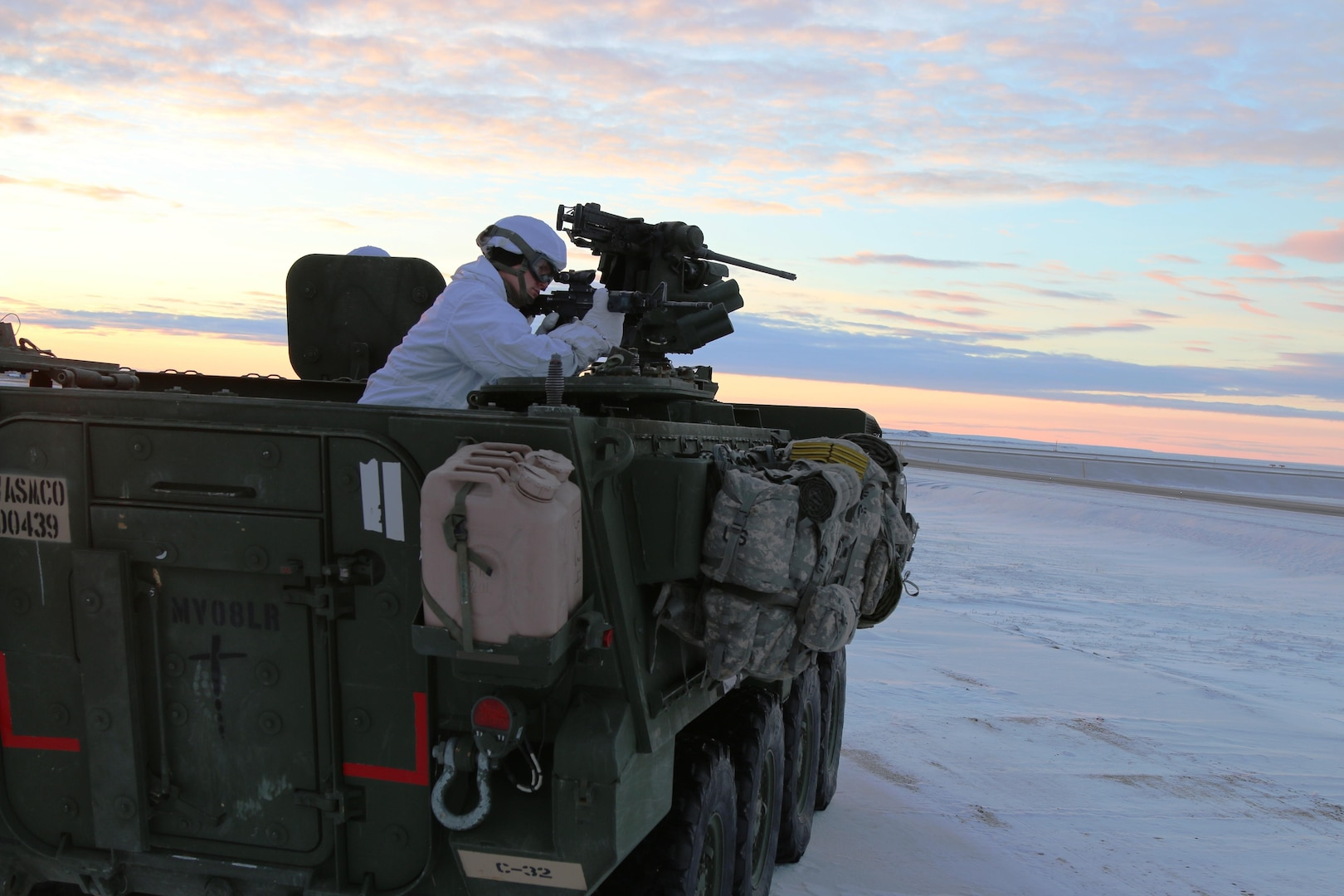 A U.S. Army Alaska Soldier with Bravo Company, 3-21 Infantry Regiment, 1st Stryker Brigade scanning the Arctic tundra outside Deadhorse, Alaska, during Operation Arctic Pegasus, Nov. 4, 2015. Arctic Pegasus is U.S. Army Alaska's annual joint exercise designed to test rapid-deployment and readiness in the Arctic. The exercise marks the first time Strykers have deployed above the Arctic Circle. 1st Stryker Brigade Combat Team is the Army's northernmost unit and has the unique capability to deploy and operate in extreme cold regions. (Photo by Capt. Richard Packer, U.S. Army Alaska Public Affairs)