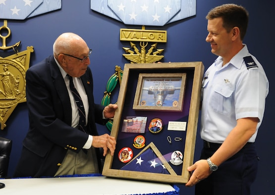 Retired Lt. Col. Dick Cole, left, one of two surviving Doolittle Raiders, accepts a shadowbox from Col. John Martin, right, 28th Operations Group commander, at the Pentagon, Arlington, Va., Nov. 5, 2015. The shadowbox was given to Cole in honor of his 100th birthday and for his role as a B-25 co-pilot during the initial U.S. raid on mainland Japan during World War II. (U.S. Air Force photo by Staff Sgt. Carlin Leslie/Released)