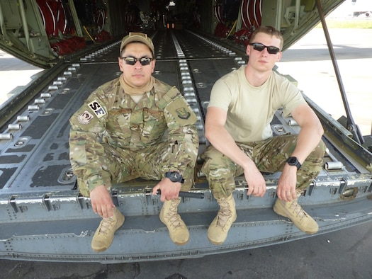 Senior Airmen Oscar Gomez-Villatoro and Joshua Coward, 319th Security Forces Squadron, pause for a photo during their deployment to Senegal. The two were part of an eight-person team that deployed from Grand Forks Air Force Base in response to the Ebola crisis in West Africa. (Courtesy photo)