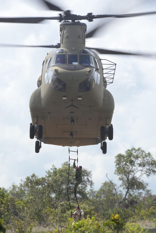 Belizean security forces practice climbing in and out of a U.S.Army CH-47 Chinook helicopter during a training mission Oct. 26, 2015, in Belize. The U.S. Army partnered with the Belizean security forces to provide airlift support to counter the cultivation of marijuana within Belize; a key contributor to various transnational criminal activities in the area. (U.S. Air Force photo by Senior Airman Westin Warburton/Released)