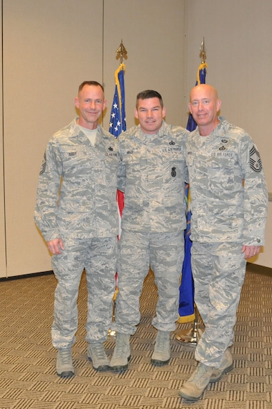 Chiefs Vanpate and Eddy congratulate newly promoted SMSgt Rob Mills following the CRTC Enlisted Call.(U.S Air National Guard photo credit SSgt. Holly Wohlford/ released)