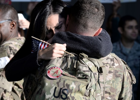 Family members welcome back 555th Fighter Squadron and Aircraft Maintenance Unit Airmen as they return from a deployment, Nov. 5, 2015, at Aviano Air Base, Italy. The 555th FS and AMU deployed more than 300 maintenance and support personnel in support of Operation New Dawn. (U.S. Air Force photo by Airman 1st Class Cary Smith/Released)