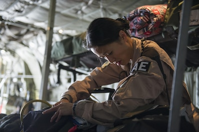 Tech. Sgt. Audrey Belmonte, 455th Expeditionary Aeromedical Evacuation Squadron medical technician deployed from the 167th AES at Charleston Air National Guard Base, W.Va., checks medical gear aboard a C-130 Hercules in preparation for a medevac mission at Bagram Airfield, Afghanistan, Nov. 6, 2015. The 455th EAES is tasked with moving injured and sick patients to locations with higher levels of medical care. (U.S. Air Force photo by Tech. Sgt. Robert Cloys/RELEASED)