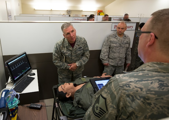 Master Sgt. Steven Kohler, 446th Aeromedical Staging Squadron medical technician, briefs Maj. Gen. John C. Flournoy, Jr., 4th Air Force commander, about the METIman patient simulator at Joint Base Lewis-McChord, Wash., November 7, 2015. 446th ASTS Airmen use the METIman simulator in the Regional Skills Laboratory to learn and practice their skills in a realistic environment. (U.S. Air Force Reserve photo by Tech. Sgt. Bryan Hull)