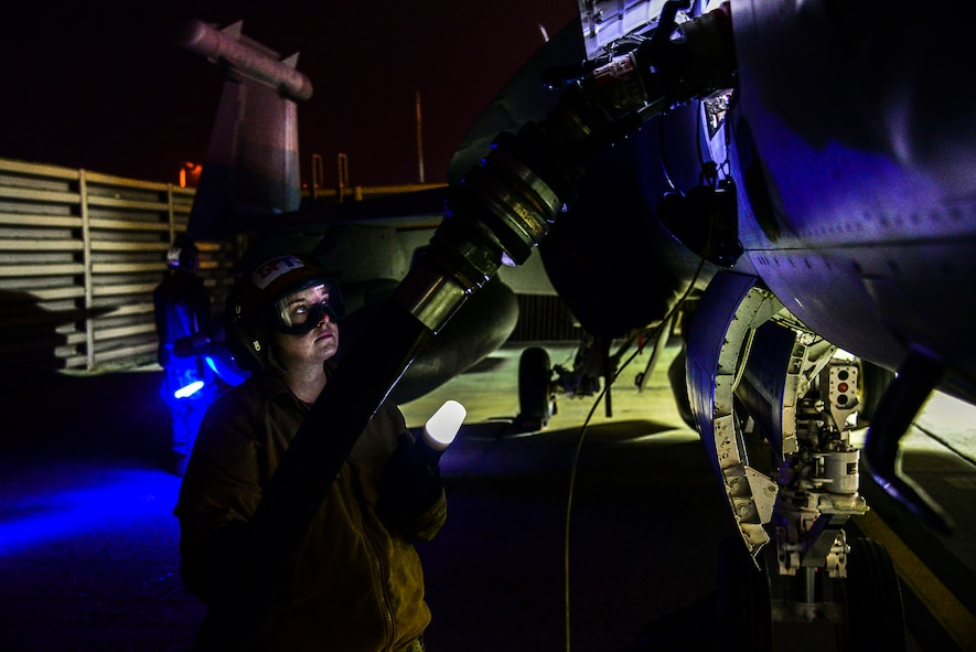 Navy Aviation Electrician's Mate Airman Apprentice Summer Blake, with Electronic Attack Squadron (VAQ) 132 from Naval Air Station Whidbey Island, Wash., ensures an EA-18G Growler properly receives fuel on the flight line during exercise Vigilant Ace 16 at Osan Air Base, Republic of Korea, Nov. 4, 2015.  The Navy's EA-18Gs are at Osan to participate in exercise Vigilant Ace 16 with their vast array of sensors and weapons capabilities. Exercise Vigilant Ace 16 is a peninsula-wide readiness exercise focused on strengthening the ROK and U.S. alliance incorporating members of four branches of the U.S. armed forces. (U.S. Air Force photo/Tech. Sgt. Travis Edwards)