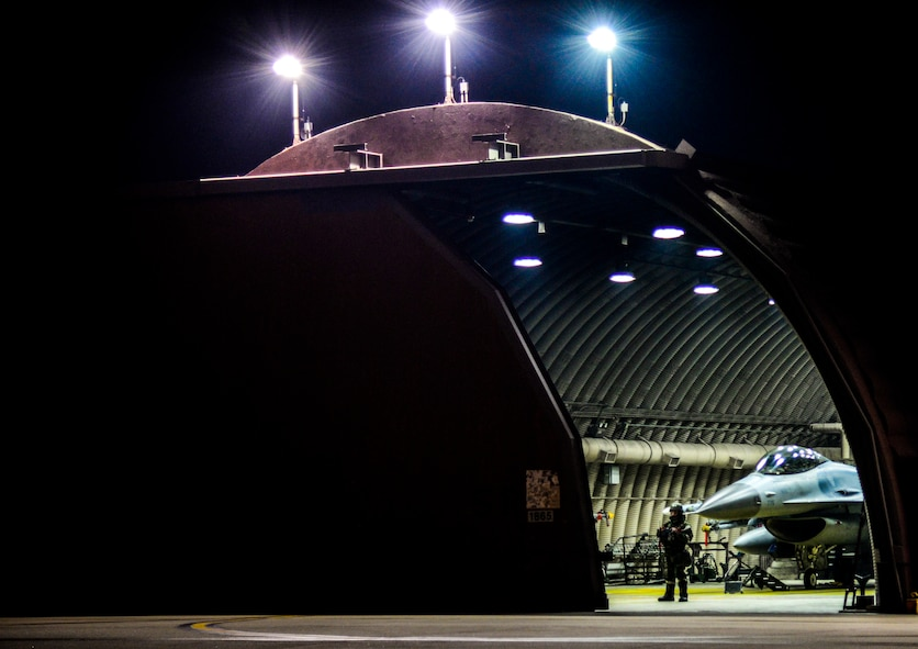 An F-16 Fighting Falcon rests as the hardened aircraft shelter closes its door for the night during exercise Vigilant Ace 16 at Osan Air Base, Republic of Korea, Nov. 4, 2015. The F-16s at Osan are part of the 36th Fighter Squadron ???Fiends??? whose mission is to conduct air interdiction, close air support and counter-air missions in day and night conditions. Exercise Vigilant Ace 16 is a peninsula-wide readiness exercise focused on strengthening the ROK and U.S. alliance.  (U.S. Air Force photo/Tech. Sgt. Travis Edwards)