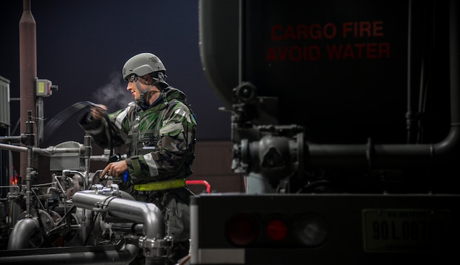 Airman 1st Class Lucas Amodeo, 51st Logistics Readiness Squadron fuels flight aircraft refueling specialist, prepares an R-11 mobile fuel truck to receive JP-8 jet fuel during exercise Vigilant Ace 16 at Osan Air Base, Republic of Korea, Nov. 4, 2015. The R-11 tanker can hold up to 6,000 gallons of fuel and can issue it out at 600 gallons per minute. Exercise Vigilant Ace 16 is a peninsula-wide exercise used to enhance the ROK and U.S. alliance through operational- and tactical-level training. (U.S. Air Force photo/Tech. Sgt. Travis Edwards)