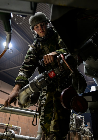Airman 1st Class Lucas Amodeo, 51st Logistics Readiness Squadron fuels flight aircraft refueling specialist, removes a pantograph refueling arm after fueling up an R-11 mobile fuel truck during exercise Vigilant Ace 16 at Osan Air Base, Republic of Korea, Nov. 4, 2015. The R-11 tanker can hold up to 6,000 gallons or 40,000 pounds of fuel and can issue it out at 600 gallons or 4,000 pounds of fuel per minute. More than 16,000 U.S. personnel will participate in Vigilant Ace 16, a large-scale training exercise that helps prepare the alliance to respond to any potential contingencies and to defend the Republic of Korea. (U.S. Air Force photo/Tech. Sgt. Travis Edwards)