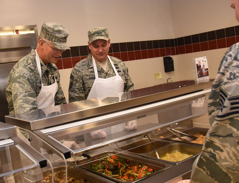 Col. Steven Parker (left), commander, 914th Airlift Wing and Chief Master Sgt. Clint Ronan (right), command chief, 914 AW, serve a holiday lunch to members of the 914 AW on Nov. 7, 2015 at the Niagara Falls Air Reserve Station. Various levels of Wing leadership served over 500 airmen a meal of turkey, ham, stuffing, gravy and sides as a way to express appreciation for all the hard work Airmen do all year. (Courtesy photo by Senior Airman Joshua Williams)