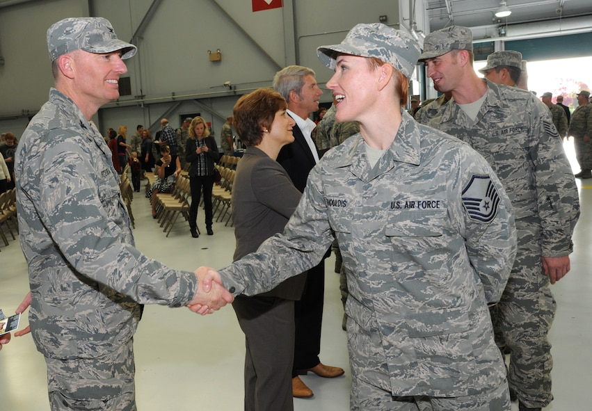 Oregon Col. Paul Fitzgerald, 142nd Fighter Wing commander, right, greets Master Sgt. Rebecca Shouldis, left, during the formal demobilization ceremony, Nov. 6, 2015, Portland Air National Guard Base, Ore. (U.S. Air National Guard photo by Tech. Sgt. John Hughel, 142nd Fighter Wing Public Affairs/Released)