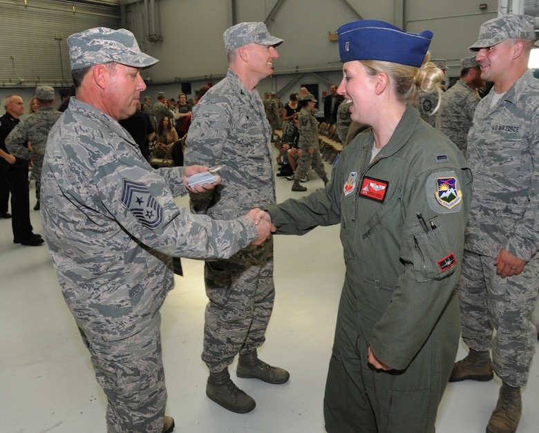 Oregon Air National Guard Chief Master Sgt. Andy Gauntz, Oregon State Command Chief, greets 1st Lt. Kimberly Uzzell, right, assigned to the 123rd Expeditionary Fighter Squadron, during the formal demobilization ceremony, Nov. 6, 2015, Portland Air National Guard Base, Ore. (U.S. Air National Guard photo by Tech. Sgt. John Hughel, 142nd Fighter Wing Public Affairs/Released)