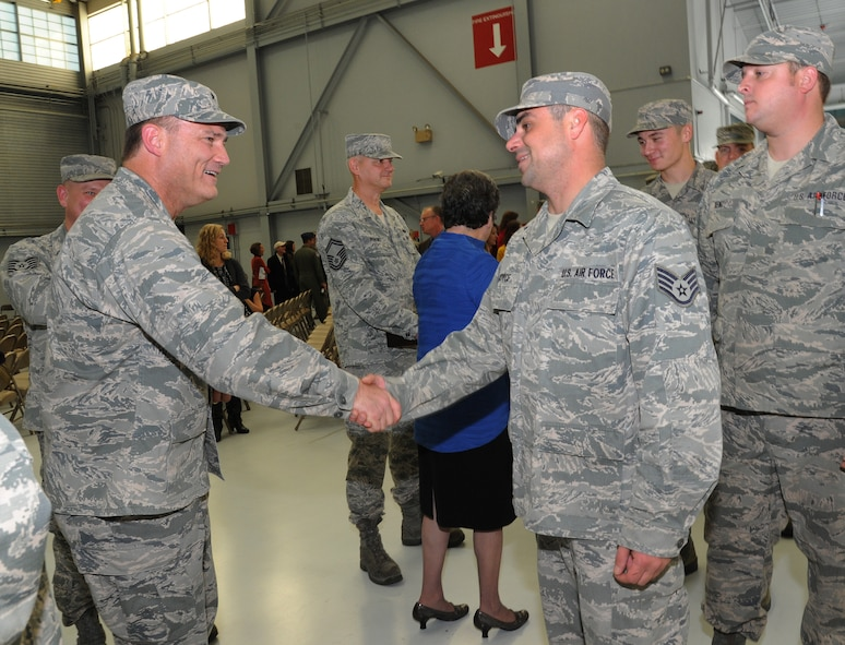 Brig. Gen. Michael E. Stencel, Adjutant General, Oregon, left, greets Staff Sgt. Joshua Joyce, assigned to the 142nd Fighter Wing Maintenance Group, right, during the formal demobilization ceremony, Nov. 6, 2015, Portland Air National Guard Base, Ore. (U.S. Air National Guard photo by Tech. Sgt. John Hughel, 142nd Fighter Wing Public Affairs/Released)
