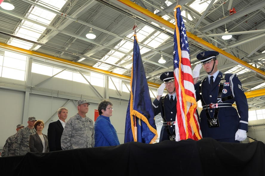 Portland Air National Guard Base Honor Guard members Staff Sgt. Bret Workman, left, and Tech. Sgt. Keven Baker, center left, render honor to the National Colors during the formal demobilization ceremony, Nov. 6, 2015, Portland Air National Guard Base, Ore. (U.S. Air National Guard photo by Tech. Sgt. John Hughel, 142nd Fighter Wing Public Affairs/Released)