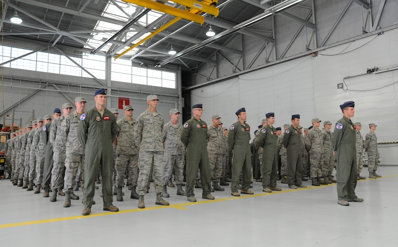 Oregon Air National Guard Airmen from the 123rd Expeditionary Fighter Squadron, 142nd Fighter Wing stand in formation and listen to remarks during their formal demobilization ceremony, Nov. 6, 2015, Portland Air National Guard Base, Ore. (U.S. Air National Guard photo by Tech. Sgt. John Hughel, 142nd Fighter Wing Public Affairs/Released)
