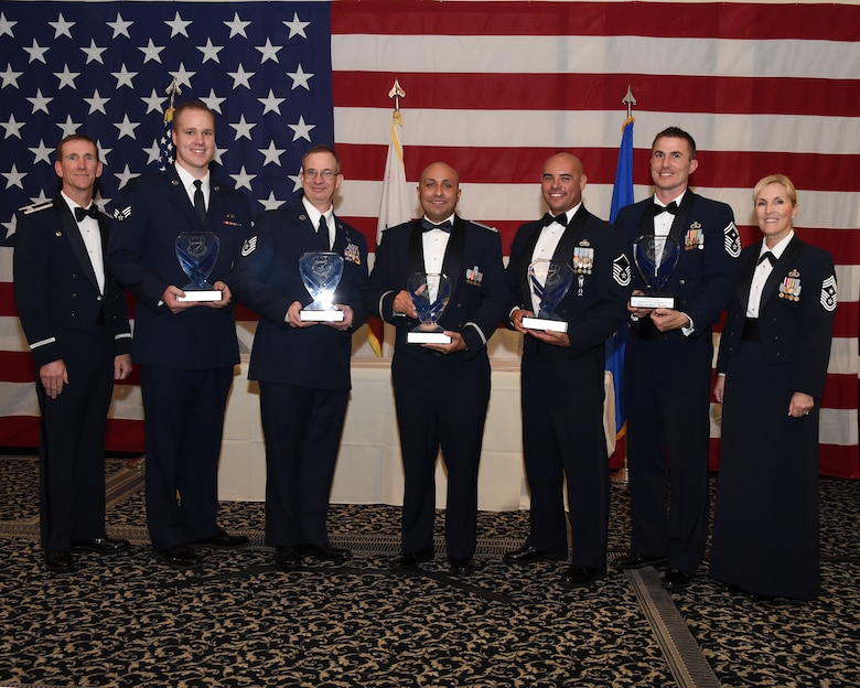 U.S. Air Force Col. Clay Garrison, far left, the commander of the 144th Fighter Wing and Chief Master Sgt. Linda Brown, far right, the 144th Fighter Wing command chief, recognize the 144th Fighter Wing Airmen of the Year. The 2015 winners of the Airmen of the Year are Senior Airman Andrew Cochran of the Maintanence Group, Tech. Sgt Gordon Pipes of the Mission Support Group, 2nd Lt. Max Montellano of the Mission Support Group, Master Sgt. Antonio Chacon of the Maintanence Group and First Sgt. Jeremiah Burleson of Fighter Wng Headquarters. U.S. Airmen attached to the California Air National Guard, 144th Fighter Wing, celebrate the Airmen of the Year, Nov. 7, 2015. (Air National Guard photo by Master Sgt. David J. Loeffler)