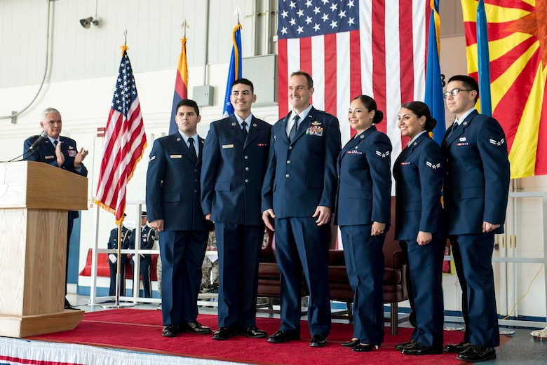 """TUCSON, Ariz. -- Junior enlisted Airmen surround 162nd Wing Commander Brig. Gen. Howard P. Purcell after they pinned on his silver star at a promotional ceremony Nov. 7 at the 162nd Wing at the Tucson International Airport. """"While we seem to be focused on my shoulders today, trust me, I know it's your shoulders that carry our wing. You guarantee our wing's priorities of success for mission and Airmen,"""" said Purcell, who is the 12th commander of the wing since its founding in 1956. (U.S. Air National Guard photo by Tech. Sgt. Hollie A. Hansen /Released)"""