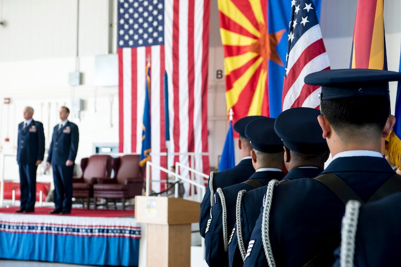 """TUCSON, Ariz. -- 162nd Wing honor guard members stand ready to proceed with their ceremonial duties before Brig. Gen. Howard P. Purcell's promotion Nov. 7 at the Tucson International Airport. Brig. Gen. Edward P. Maxwell, commander of the Arizona Air National Guard, far left, stands next to Purcell before the start of the ceremony. Maxwell officiated the ceremony, and noted Purcell's promotion was """"well-deserved."""" (U.S. Air National Guard photo by Tech. Sgt. Hollie A. Hansen /Released)"""