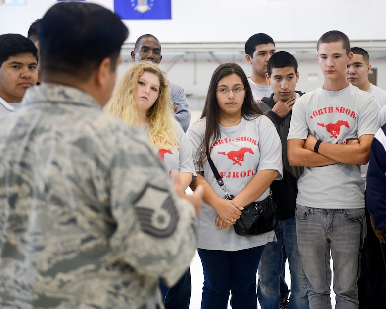 North Shore High School Air Force Junior Reserve Officer Training Corps cadets toured the 147th Reconnaissance Wing at Ellington Field in Houston November 7, 2015. The cadets stopped at the Air Support Operations Squadron to speak with Tactical Air Control Party members and Joint Terminal Attack Controllers about their job as well as the wing's hangar to learn about the MQ-1 Predator.