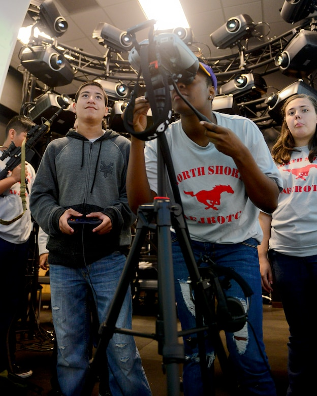 North Shore High School Air Force Junior Reserve Officer Training Corps cadets toured the 147th Reconnaissance Wing at Ellington Field in Houston November 7, 2015. The cadets stopped at the Air Support Operations Squadron to speak with Tactical Air Control Party members and Joint Terminal Attack Controllers about their job as well as fly a virtual airplane and trek through a mock deployment zone in the squadron's new $2 million Air National Guard Advanced Joint Terminal Attack Controller Training System.