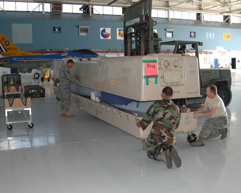 Members of the 147th Reconnaissance Wing Maintenance Wing open the crate holding an MQ-1 Predator at Ellington Field Joint Reserve Base in Houston on August 18, 2009. The wing transitioned from the F-16 to the MQ-1 and this is the first Predator delivered to the unit.