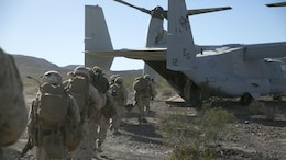 Marines with Bravo Company, 1st Battalion, 8th Marine Regiment, board an MV-22 Osprey after recovering a downed pilot during a tactical recovery of aircraft personnel mission as part of Integrated Training Exercise 1-16 at Marine Air Ground Combat Center, Twentynine Palms, Calif., Nov. 5, 2015. Marines with Bravo Company, 1st Battalion, 8th Marine Regiment, are participating in a wide variety of exercises throughout ITX to prepare for their upcoming deployment with Special Purpose Marine Air-Ground Task Force Crisis Response-Africa.
