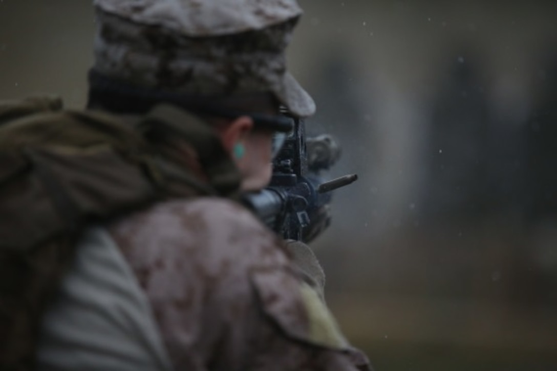 A round leaves the chamber of a Marine's M4 carbine assault rifle during Expeditionary Operations Training Group's close quarters tactics course before he switches to use his pistol at Camp Lejeune, N.C., Nov. 3, 2015. These drills tested the Marines with 2nd Reconnaissance Battalion's ability to change between the two weapons systems, simulating a malfunction or depleting their ammunition. (U.S. Marine Corps photo by Lance Cpl. Dalton A. Precht/Released)