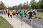 Runners take off from the start line at the HQC Halloween 5K Run/Walk Nov. 5 at the McNamara Headquarters Complex.