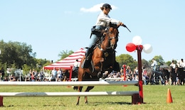 Trooper Nicole Fox, Commanding General Mounted Color Guard demonstrates riding and shooting skills during Fall Apple Day Festival Sept. 26.