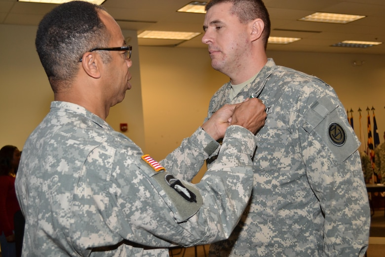 Maj. Gen. A.C. Roper, commander 80th Training Command, awards the Army Commendation Medal to Maj. David Porter, 102nd Training Division, for winning the 80th TC Instructor of the Year Award, during a ceremony at Fort Knox, Ky., Nov. 7, 2015.