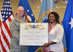 DLA Aviation Business Process Support Directorate's Catina Jeffrey, a supply systems analyst, accepts the September 2015 Employee of the Month Award from DLA Aviation Commander Air Force Brig. Gen. Allan Day Nov. 5, 2015 during a ceremony in Building 34 on Defense Supply Center Richmond, Virginia.