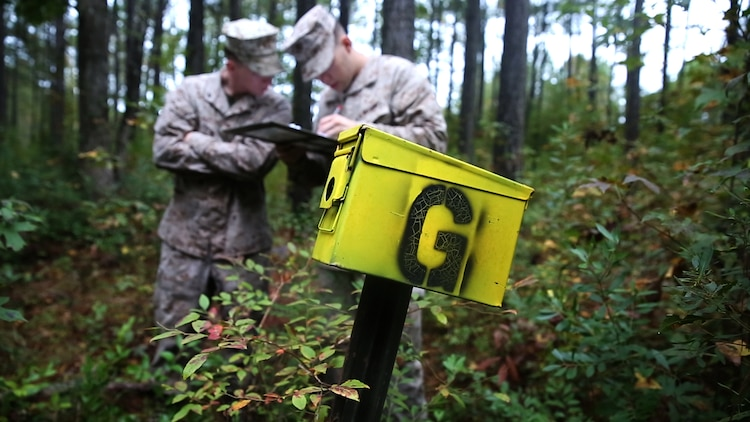 Marines with Motor transportation Company, 2nd Maintenance Battalion, take down the name of one