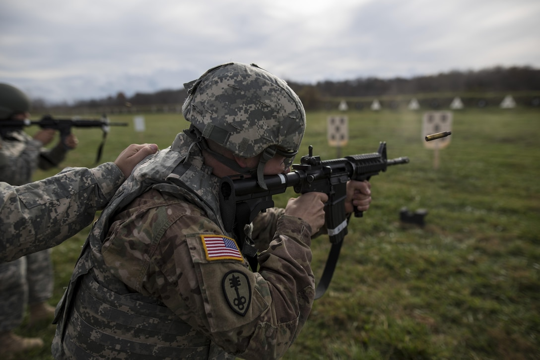 U.S. Army Reserve Soldiers from military police and drill sergeant units fire their rifles at a qualification range during a multi-day training event hosted at Camp Atterbury, Ind., Nov. 6. The 384th Military Police Battalion, headquartered at Fort Wayne, Ind., organized a three-day range and field training exercise involving more than 550 U.S. Army Reserve Soldiers and incorporated eight different weapons systems, combat patrolling and a rifle marksmanship competition at Camp Atterbury, Ind., Nov. 5-7. (U.S. Army photo by Master Sgt. Michel Sauret)