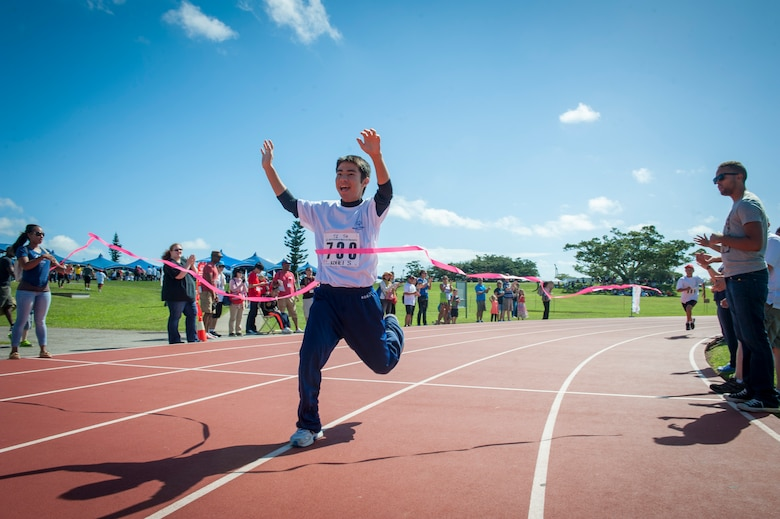 Kohei Setake, a Kadena Special Olympics athlete, wins first place in a 200 meter dash during the Kadena Special Olympics Nov. 7, 2015, at Kadena Air Base, Japan. Established by the 18th Wing commander in 2000, KSO is a sporting and entertainment event that provides an opportunity for all communities involved to stand together in support of people with special needs. (U.S. Air Force photo by Airman 1st Class Lynette M. Rolen)