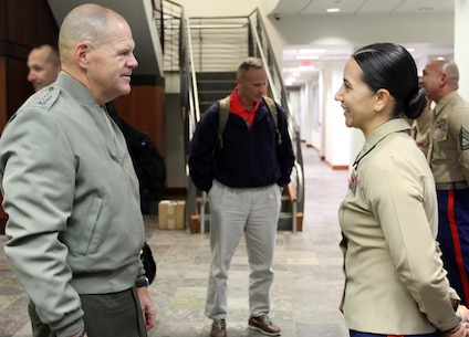 Commandant of the Marine Corps, Gen. Robert B. Neller, speaks with Commanding Officer of Recruiting Station Los Angeles, Maj. Aixa Dones, after he presented the Marines of RS Los Angeles with his challenge coin, Nov. 6, 2015. The commandant flew in to Los Angeles to attend the Reagan National Defense Forum, and upon landing at the Camarillo airport, he recognized the Marines for their hard work and dedication in recruiting efforts. (U.S. Marine Corps photo by Sgt. Alicia R. Leaders/Released)