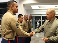 Commandant of the Marine Corps, Gen. Robert B. Neller, presents Sgt. Jose Morales, recruiter from Recruiting Sub Station Downey, with his challenge coin, Nov. 6, 2015, after winning rookie recruiter of Recruiting Station Los Angeles. The commandant flew in to Los Angeles to attend the Reagan National Defense Forum, and upon landing at the Camarillo airport, he recognized the Marines for their hard work and dedication in recruiting efforts. (U.S. Marine Corps photo by Sgt. Alicia R. Leaders/Released)