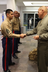 Commandant of the Marine Corps, Gen. Robert B. Neller, presents Staff Sgt. Francisco Soto, recruiter from Recruiting Sub Station Granada Hills, with his challenge coin, Nov. 6, 2015, after winning recruiter of the year for the Western Region. The commandant flew in to Los Angeles to attend the Reagan National Defense Forum, and upon landing at the Camarillo airport, he recognized the Marines for their hard work and dedication in recruiting efforts. (U.S. Marine Corps photo by Sgt. Alicia R. Leaders/Released)