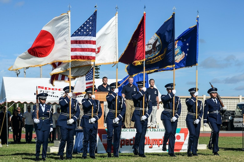 U.S. Air Force Airmen from the 18th Wing Honor Guard present the colors during the Kadena Special Olympics opening ceremony Nov. 7, 2015, at Kadena Air Base, Japan. Established by the 18th Wing commander in 2000, KSO is a wholesome sporting and entertainment event that provides an opportunity for all communities involved to stand together in support of people with special needs. (U.S. Air Force photo by Senior Airman John Linzmeier)