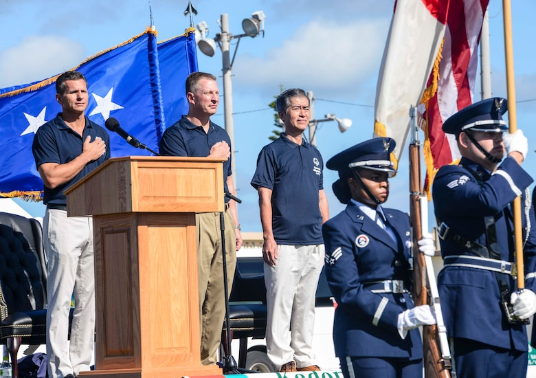 U.S. Air Force Brig. Gen. Barry Cornish, 18th Wing commander, U.S. Air Force Lt. Gen. John Dolan, 5th Air Force commander, and Masaru Machida, Okinawa Prefectural Government Executive Office of the Governor director general, stand as the U.S. National Anthem is played during the Kadena Special Olympics opening ceremony Nov. 7, 2015, at Kadena Air Base, Japan. The KSO is sponsored by the 18th Wing and the Friends of Kadena Special Olympics in partnership with the Okinawa Prefectural Government, Okinawa City, Kadena Town, Chatan Town and all U.S. military services on island. (U.S. Air Force photo by Senior Airman John Linzmeier/Released)