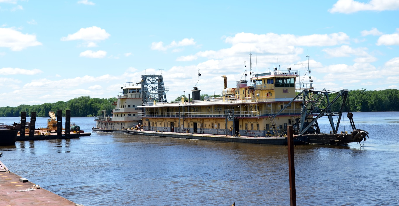 The Dredge William A. Thompson leaves the U.S. Army Corps of Engineers service base in Fountain City, Wis., for the last time June 12. The Thompson's new home will be with the Community Development Alternatives, Inc., in Prairie du Chien, Wis.
